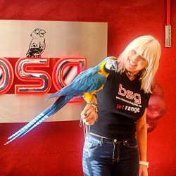 Karen Waldron and a Barber Shop parrot