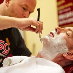 Cut throat shave at The Barber Shop Group